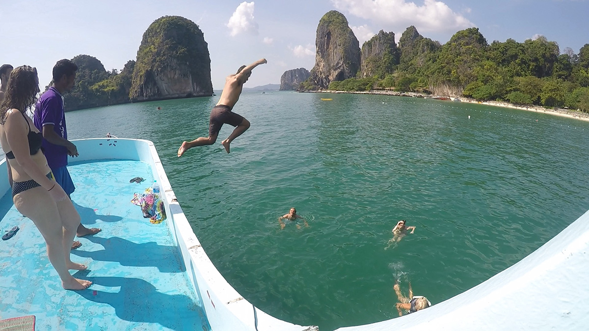Jumping off the top level of the boat.